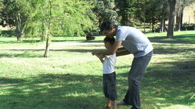 Father teaching his son how to play baseball stock video