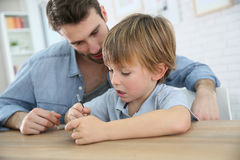 Father teaching his son how to use a smartphone Stock Images