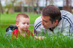 Father teaching his son about the nature Royalty Free Stock Photography