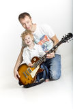 Father is teaching his son to play electric guitar Royalty Free Stock Photography