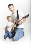 Father is teaching his son to play electric guitar Stock Image