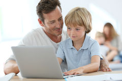 Father teaching his son using laptop Royalty Free Stock Photo
