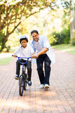Father teaching son bicycle Stock Photos