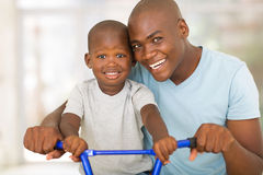 Father teaching son bicycle Royalty Free Stock Photo