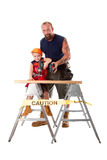 Father teaching son drilling Royalty Free Stock Photos