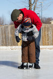 Father teaching son how to ice skate Stock Photography