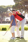 Father Teaching Son To Play Golf Royalty Free Stock Photo
