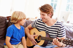 Father Teaching Son To Play Guitar Stock Images