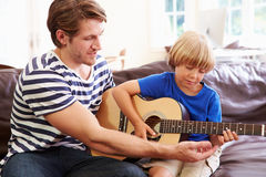 Father Teaching Son To Play Guitar Stock Photos