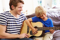 Father Teaching Son To Play Guitar Royalty Free Stock Photos