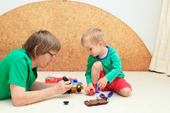 Father teaching son to repair truck Royalty Free Stock Photo