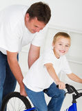 Father teaching son to ride Royalty Free Stock Photos