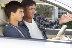 Father Teaching Teenage Son To Drive Royalty Free Stock Photo