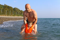 Father teaching  to swim his 2 years son Stock Photo