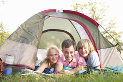 Father With Teenage Children On Camping Holiday In Countryside Stock Images