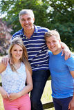 Father With Teenage Children Walking In Countryside Stock Photography