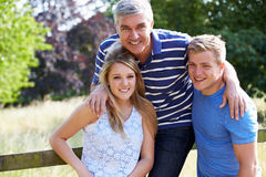 Father With Teenage Children Walking In Countryside Royalty Free Stock Images