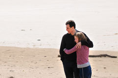 Father and teenage daughter at the beach. Portrait of father and teenage daughter royalty free stock image