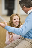 Father and teenage daughter conversing Stock Images