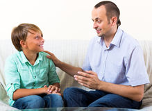 Father and teenage son discussing Stock Images