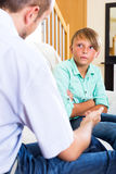 Father and teenage son discussing Royalty Free Stock Image