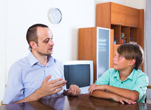 Father and teenager discussing serious Stock Photos