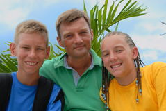 Father with teens outdoors Stock Photography