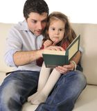 Father telling fairy tale to cute little daughter Royalty Free Stock Photos