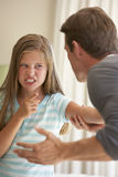 Father Telling Off Daughter At Home Royalty Free Stock Photography