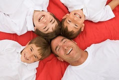 Father and Three Sons. All Smiling royalty free stock image