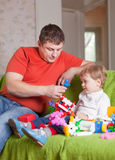 Father and  three-year child   in home Stock Images