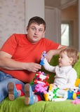Father and  three-year child plays  in home Royalty Free Stock Photos