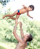 Father throwing his son Stock Photography