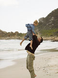 Father throwing his son in the air. Stock Photo