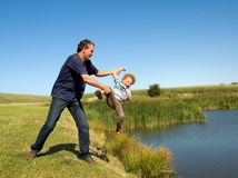 Father throwing Kid royalty free stock photography