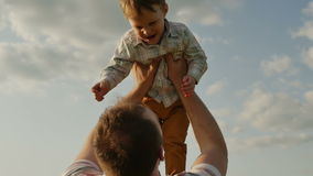 Father throwing son in air. slow motion stock footage