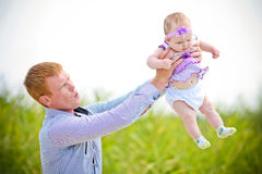 Father throws the daughter Stock Images