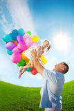 Father throws daughter. Familly playing together in park with ba Royalty Free Stock Images