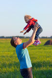 Father throws his happy baby in the sky. Love and happiness. Happy carefree childhood Royalty Free Stock Images