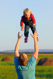 Father throws his happy baby in the sky. Love and happiness. Happy carefree childhood Royalty Free Stock Image