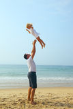 Father throws his infant child Stock Image