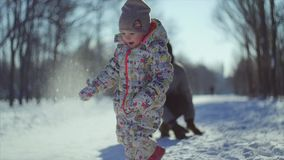 4K Snowball game. Father and his little child play winter snowball game. stock video