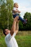 Father throws to the top the son Stock Photos