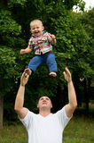 Father throws to the top the son Stock Photo