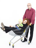 Father thrusting shop cart with mother, daughter Stock Images