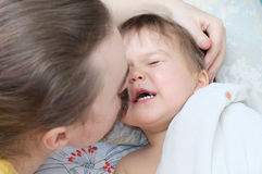 Father tickle little baby daughter with mustache. Dad tickle little baby daughter with mustache Stock Photo
