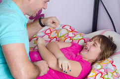 Father tickling daughter Stock Photography