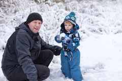 Father and toddler boy having fun with snow Royalty Free Stock Photo