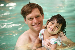 Father and toddler boy swimming. In pool royalty free stock photos