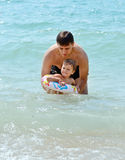 Father and toddler daughter in the sea water Royalty Free Stock Image